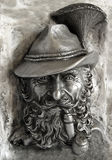 Bas-relief with Bearded smoker Royalty Free Stock Images