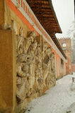 The bas-relief on biblical themes. In snowfall in the Moscow monastery Stock Photos