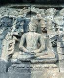 Bas relief buddha. Bas relief with buddha meditating in lotus position royalty free stock photo