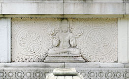Bas relief of buddha Stock Photo