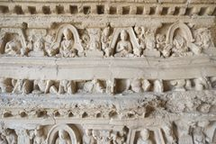 Bas-relief of Buddha and monks on the Stupa at Jaulian monastery. royalty free stock image