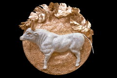 Bas-relief - a bull. Composition for a habitation ornament - the designer Ekaterina Denisenko Stock Photo
