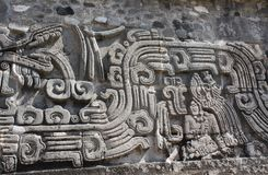 Bas-relief carving with of a american indian chieftain, Xochicalco, Mexico. Bas-relief carving with of a american indian chieftain and god Quetzalcoatl, pre royalty free stock photos