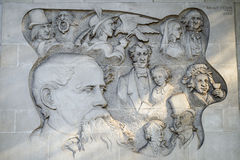 Bas Relief Carving of Charles Dickens Characters in London Stock Photo