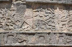 Bas-relief carving of eagle, chieftain and snake, Chichen Itza,. Bas-relief carving of eagle, chieftain and snake, pre-Columbian Maya civilization, Chichen Itza stock photography