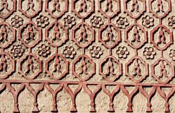 Bas-relief carving with floral ornament on old stucco wall, Mexi Stock Photography