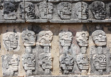 Bas-relief carving with human skulls on Tzompantli , Chichen Itz Stock Photography