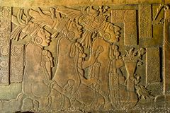 Bas-relief carving at the Palenque ruins Chiapas Mexico. Bas-relief carving closeup at the Palenque ruins in Chiapas Mexico royalty free stock photo