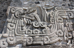Bas-relief carving with of a Quetzalcoatl, Xochicalco, Mexico Stock Images