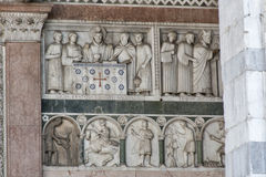 Bas relief on the Cathedral of St Martin wall, Lucca, Italy Royalty Free Stock Photography