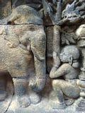 Bas Relief che mostra la fase differente della vita di Lord Buddha verso nirvana, tempio di Borobudur, Java centrale, Indonesia Immagini Stock Libere da Diritti