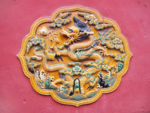 Bas-relief with Chinese dragon. Ornament with Chinese dragon, bas-relief on palace's wall Royalty Free Stock Photography