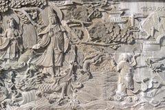 Bas-relief chinois, pierre, grise Images libres de droits