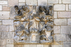 Bas Relief. A bas relief on the cloisters at the Ancient Spanish Monastery Stock Photo