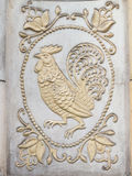 Bas-relief with a cock Royalty Free Stock Photo