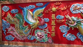 Bas-relief of crane and dragon stock video