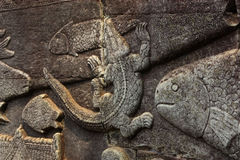 Bas Relief of Crocodile Stock Images