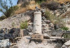 The bas-relief of the cross on the remains of the column in ruins of Kursi - a large Byzantine 8th-century monastery on the shores. Of Lake Tiberias, on the Stock Photography