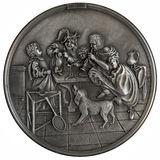 Bas-relief Dancing lesson. Metal bas-relief on the story by Dutch painter Jan Havickszoon Steen isolated on white background Stock Photos