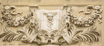 Bas-relief depicting the god of commerce Hermes Mercury. On the facade of an old house stock images