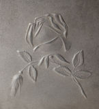 Bas-relief depicting roses on metal Stock Photos