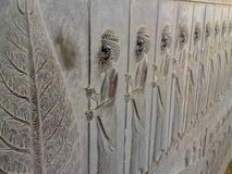 Bas-relief depicts guards - warriors of king. Ancient relief on the wall of the ruined city of Persepolis royalty free stock photos