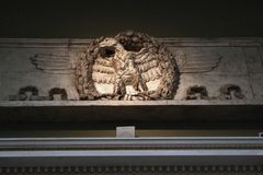 Bas-relief of an eagle, the symbol of the Roman Empire. Stock Photos