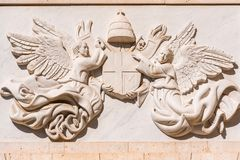Bas-relief on the facade of the building two angels, Madrid, Spain. Close-up. Royalty Free Stock Images