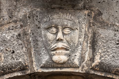 Bas-relief with face on ancient house facade Stock Photography
