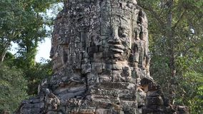 Bas-relief of the face on the ancient wall in Angkor Thom temple complex, Cambodia stock footage