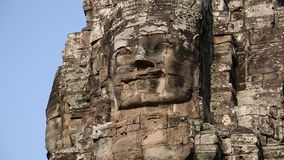 Bas-relief of the face in Bayon - ancient Khmer temple in Angkor Thom temple complex, Cambodia stock footage