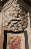 Bas Relief. A Bas Relief Face carved out of stone at a church in Cagliari on the island of Sardinia in Italy Royalty Free Stock Photos