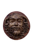 Bas-relief Faunus  of the Greek deity made on wood isolated on w Royalty Free Stock Photo