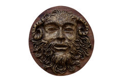 Bas-relief Faunus  of the Greek deity made on wood isolated on w Stock Photography