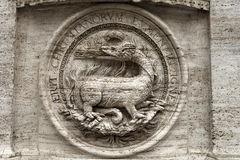 Bas-relief of a fire-breathing dragon Royalty Free Stock Photography