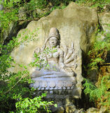 Bas-relief of the goddess Guan Yin on the rock Royalty Free Stock Photography