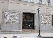 Bas-relief granite sculptures, Robert N.C. Nix, Sr. Federal Building & Post Office. Pictured are two granite relief sculptures by Edmond Amateis flanking the stock images