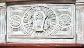 Bas-relief with a hammer and sickle of the ussr. Retro bas-relief with a hammer and sickle of the ussr outdoor closeup royalty free stock image