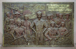 Bas-relief of Ho Chi Minh with troops and workers. Royalty Free Stock Images