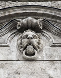 Bas-relief in the ideal head of a lion Royalty Free Stock Images