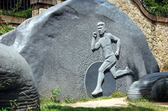 Bas relief with the image of athlete Stock Image