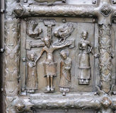 Bas-relief with Jesus Christ on ancient bronze gate in Veliky No Royalty Free Stock Photo