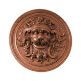 Bas relief lion isolated white. An object isolated on white: decorative old aged wooden bas-relief (carving, fretwork) with lion head Royalty Free Stock Photos