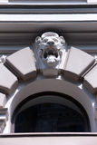 The bas-relief of a lion on the wall above the window Stock Photo