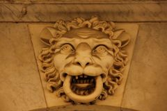 Bas Relief. A Bas Relief of a lions head on the outside of a building in Cadiz, Spain Royalty Free Stock Image