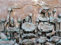 Bas-relief on the lotus. Public Stock Photography