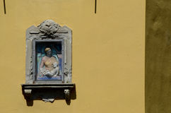 Bas-relief of the Madonna with Jesus on the wall. Assisi. Stock Images