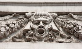 Bas-relief man's face Stock Photography