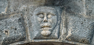 Bas-relief with mans face Stock Photo