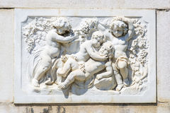 Bas-relief marble sculpture with babies stock images